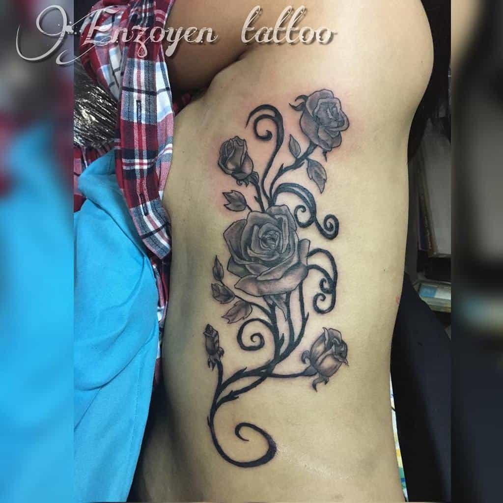 side tribal rose tattoos mr.gutierrez_tattoo