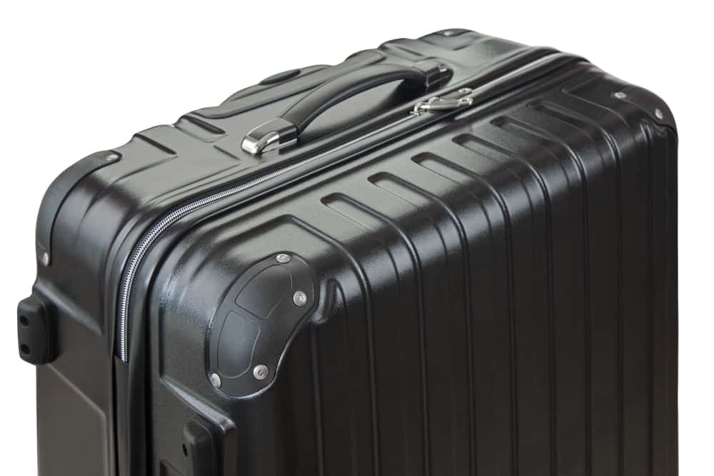 side view of big black lightweight hard shelled suitcase