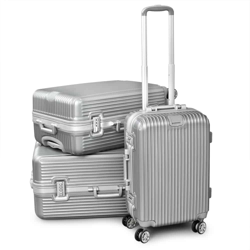 silver travel suitcase isolated on white background