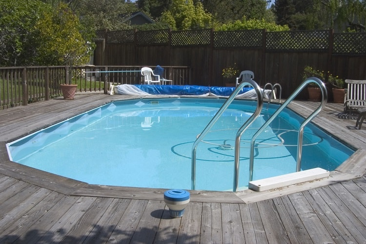 Simple Backyard Above Ground Pool Wrapped Around Deck