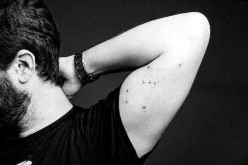 Simple Bicep Male Constillations Tattoo Design
