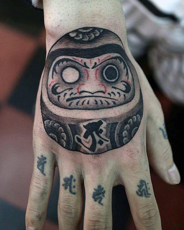 60 daruma doll tattoo designs for men japanese ink ideas for Male hand tattoos