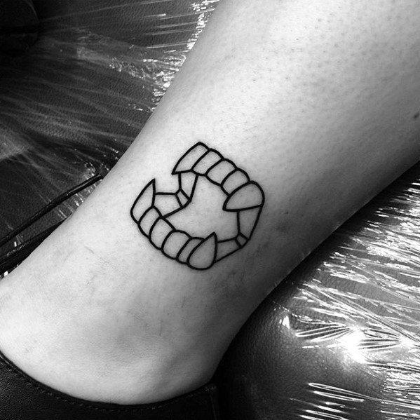 Simple Leg Black Ink Outline Vampire Fangs Tattoo For Men