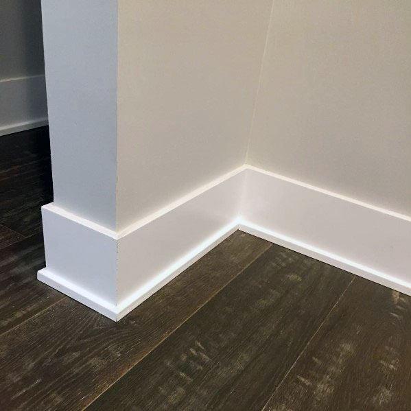 Simple Modern Baseboard Ideas With Hardwood Flooring