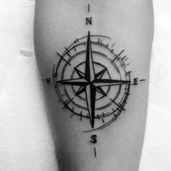 Simple Nautical Star Compass Travel Leg Tattoo On Gentleman With Black Ink