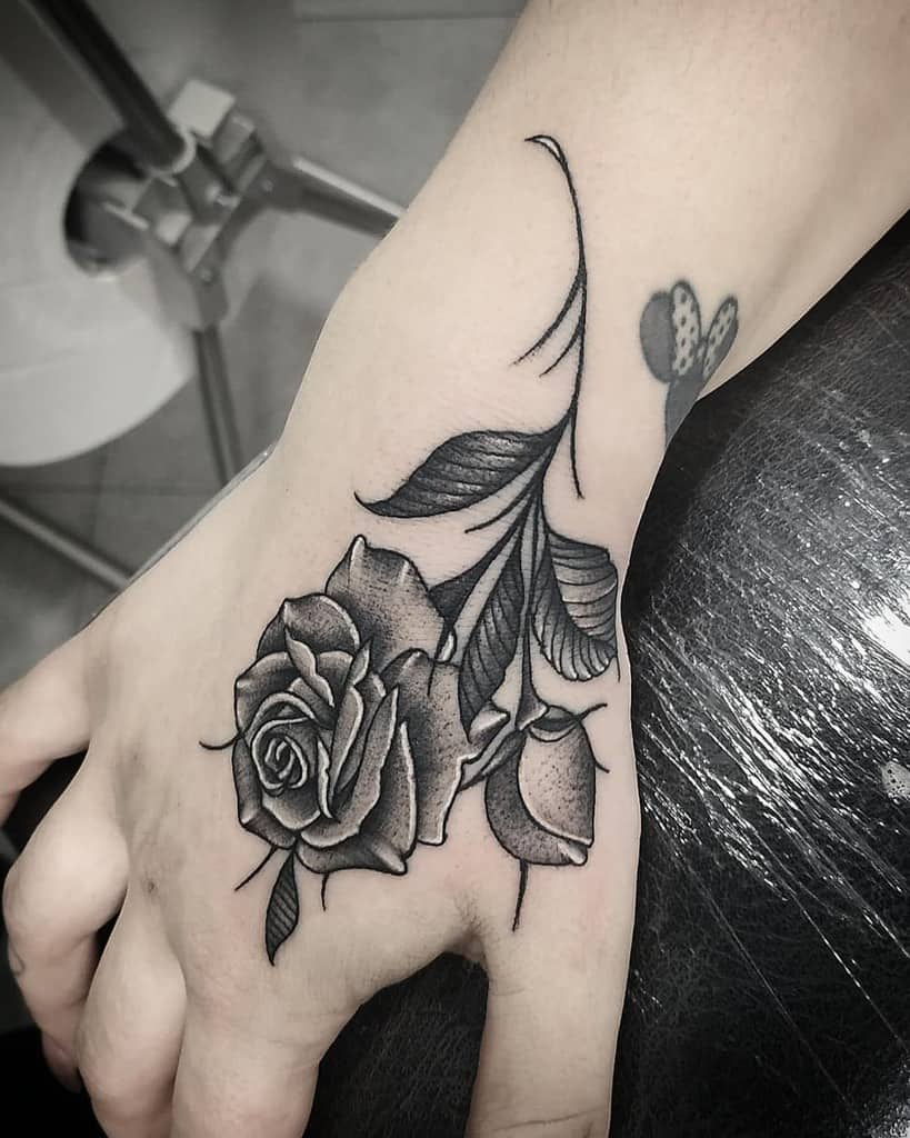 simple rose hand tattoos ronaldo_tattooartist