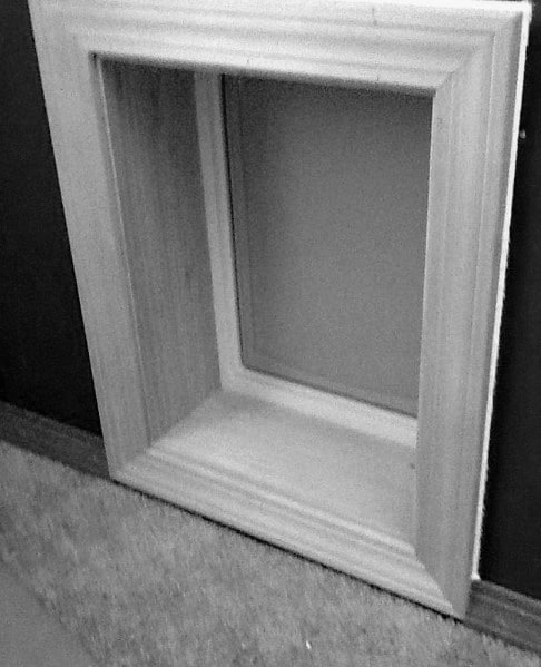 Simple Square Framed Molding Doggy Door Ideas
