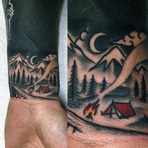 Simple Tent And Fire Wrist Tattoo On Gentleman