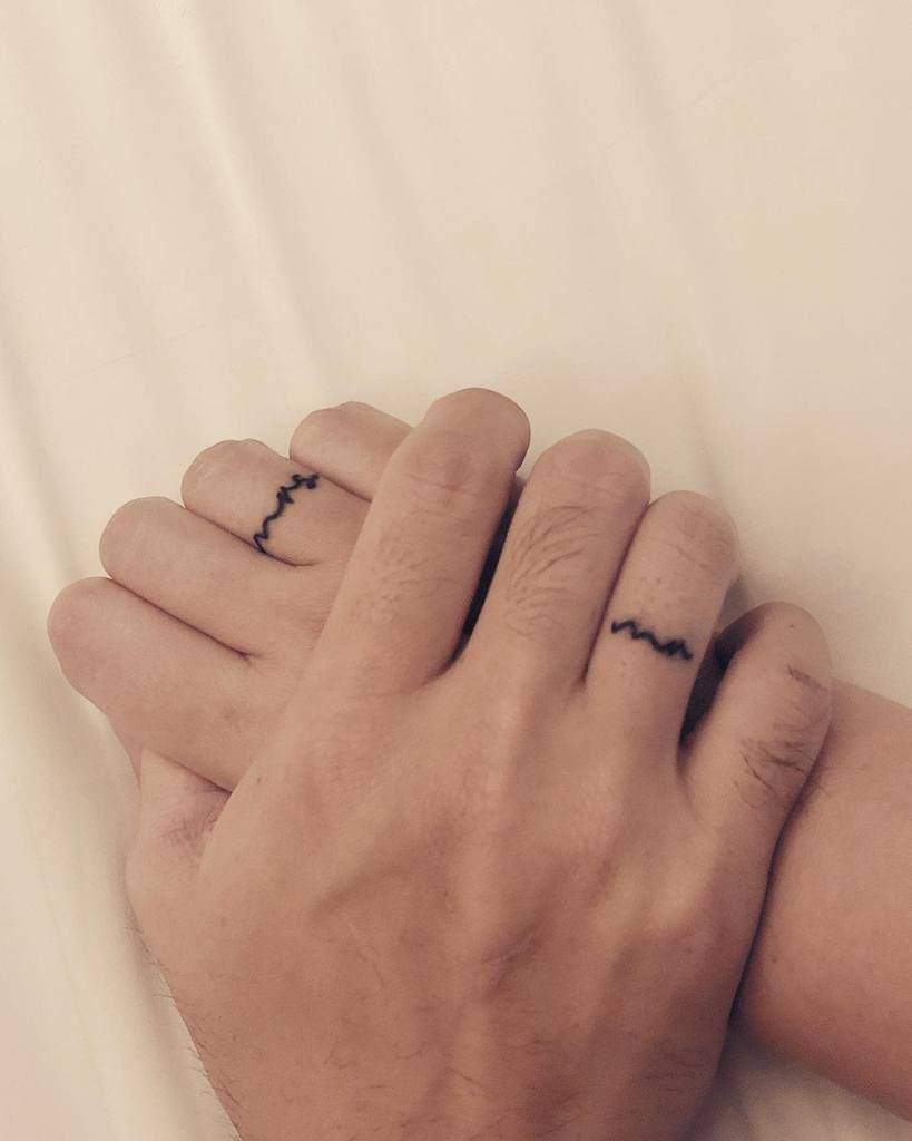 Simple Themed Wedding Ring Tattoo Tifanny.natalia