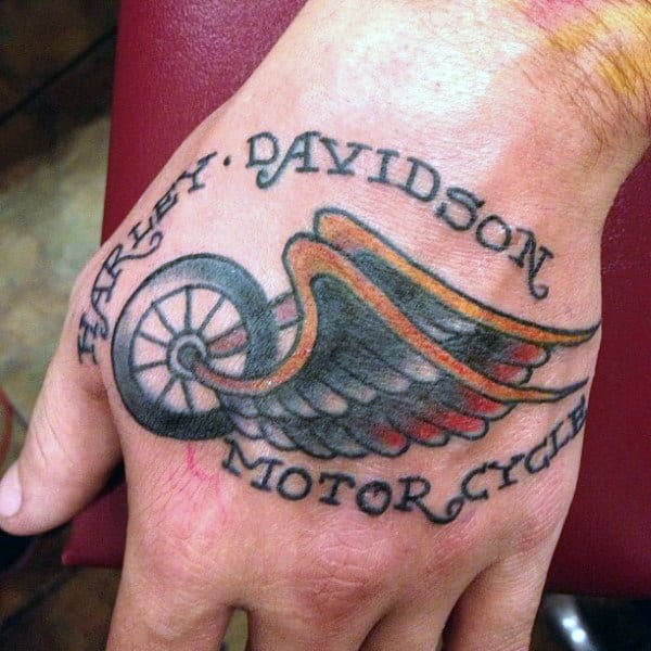 Simple Traditional Harley Davidson Wheel With Wings Male Tattoos