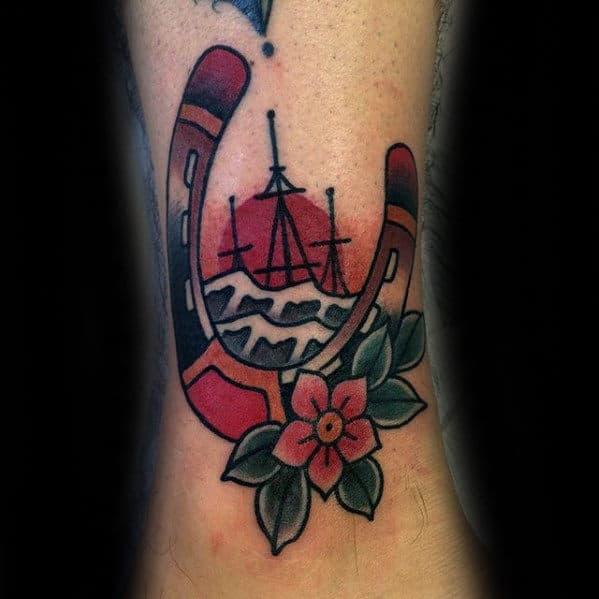 Sinking Ship With Horseshoe Guys Traditional Lower Leg Tattoo
