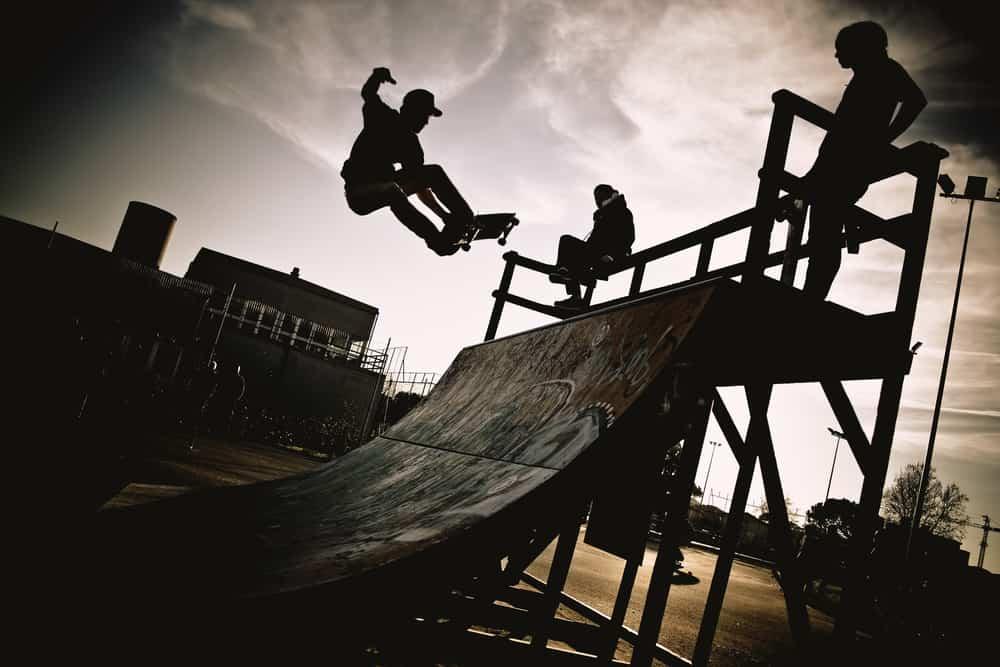 skateboarder jumping on ramp