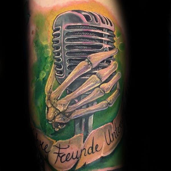 Skeleton Hand Holding Miccrophone Mens Arm Tattoos