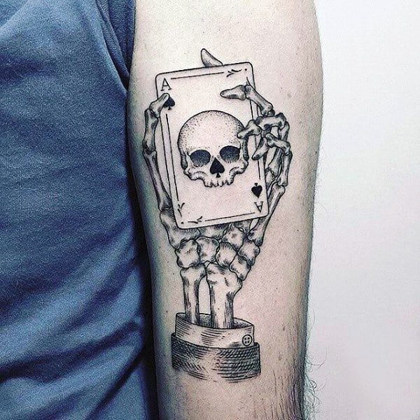 Skeleton Hand With Ace Of Spades Playing Card Tattoo On Male