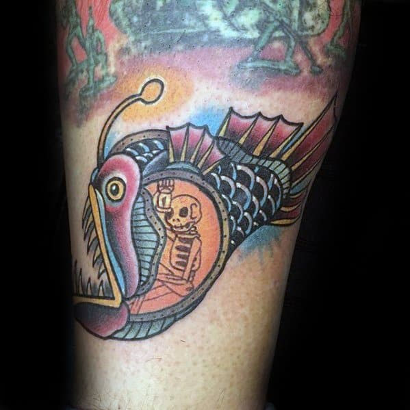 Skeleton Inside Angler Fish Tattoo Design On Man