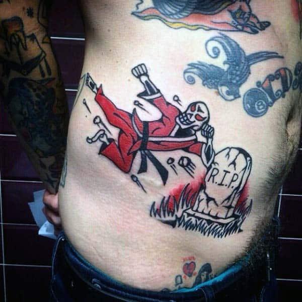 Skeleton Ninja Rip Tombstone Tattoo Design On Rib Cage Side Of Guy