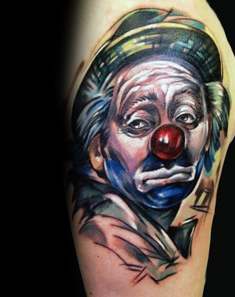 Sketched Watercolor Male Clown Upper Arm Tattoos