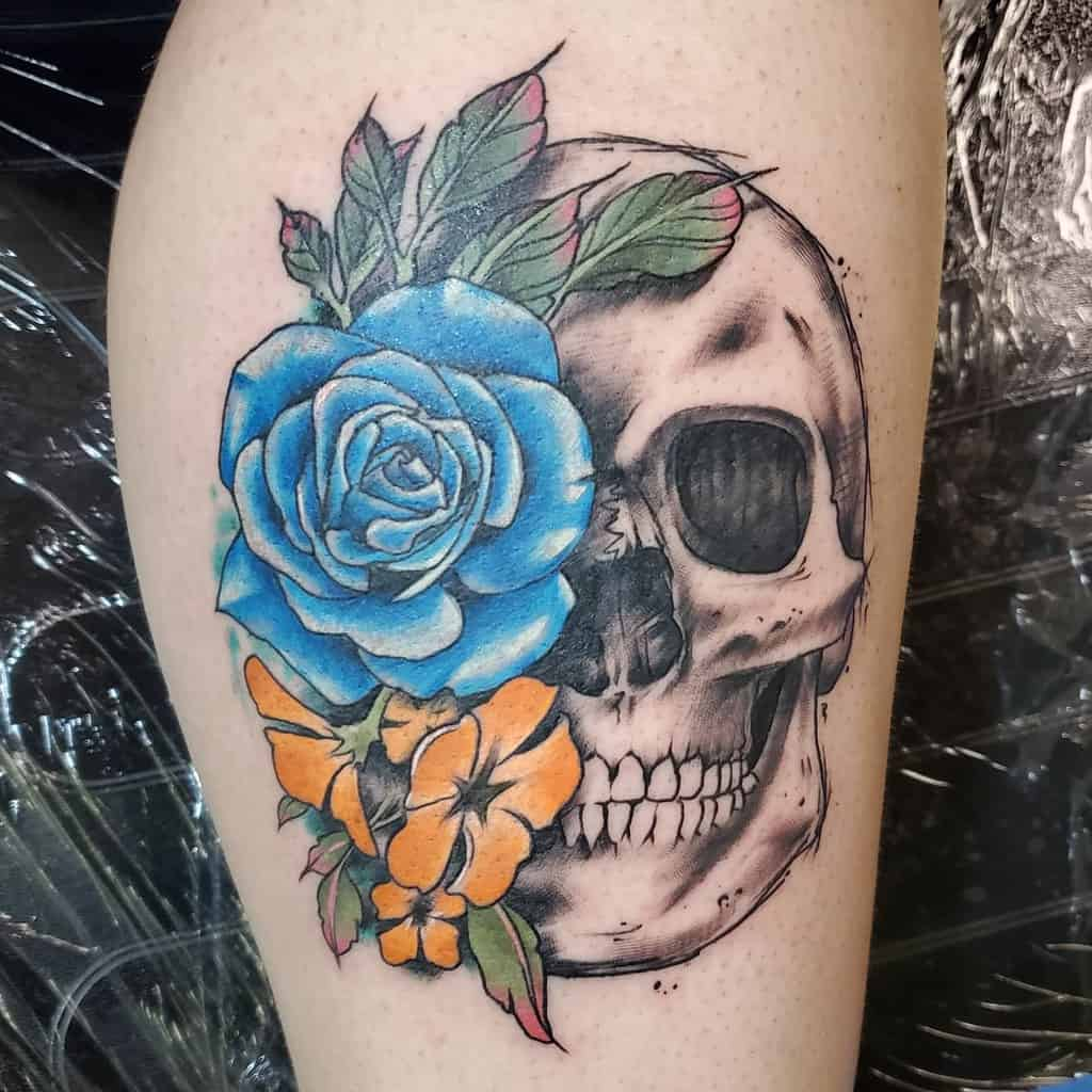 skull-and-rose-leg-tattoo-rhodestattoo