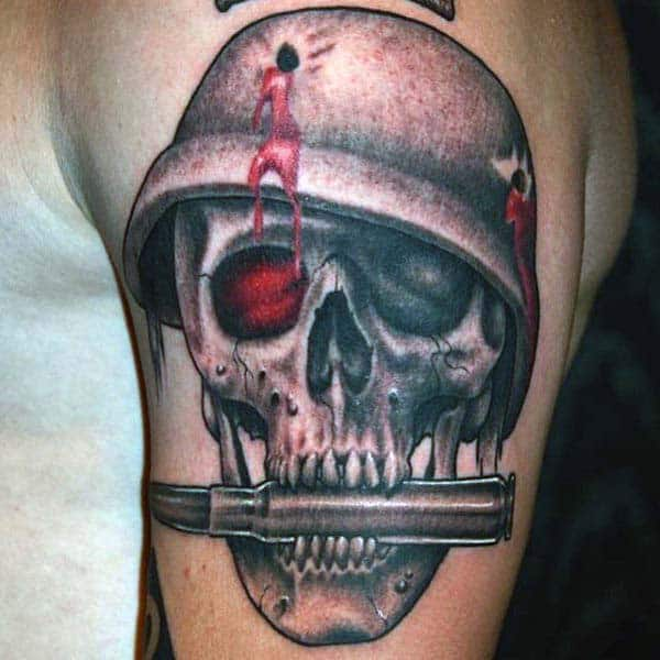 Skull Bite The Bullet Tattoo For Men On Upper Arm