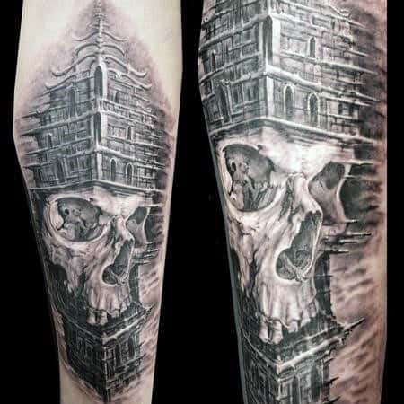 Skull Building Mens Arm Tattoos