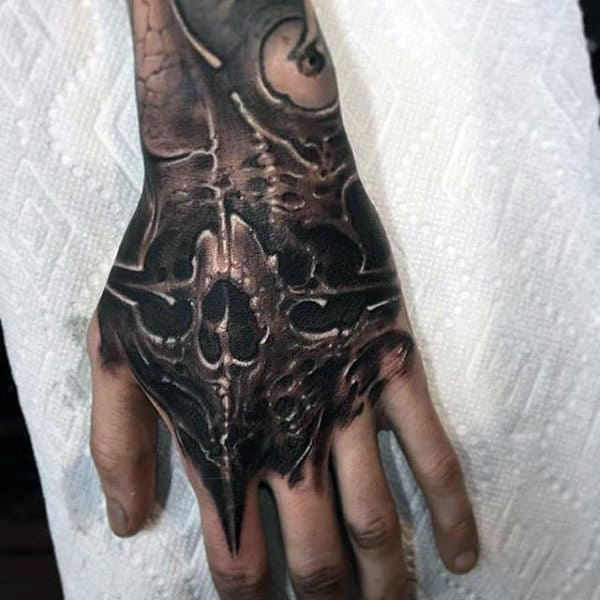 Skull Hand Insane Guys Tattoo