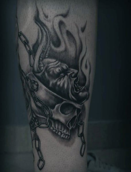 Skull Male With Chain And Cross Tattoo