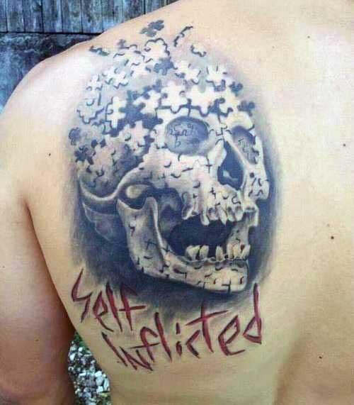 Skull Puzzle Piece Mens Back Tattoo Design