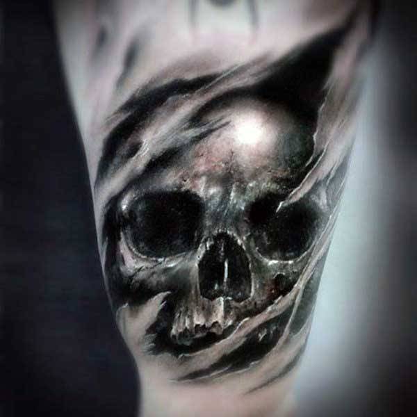 Skull Ripping Through Skin Tattoo On Arm