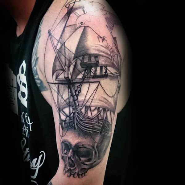 Skull Sailing Ship Nautical Upper Arm Tattoo On Gentleman