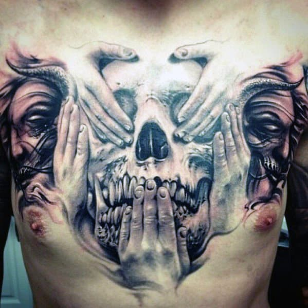 Hands And Skull Tattoos
