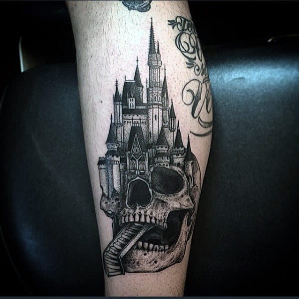 Skull Themed Castle Mens Tattoo In Black Ink On Arm