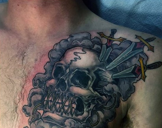 Skull Three Of Swords Tattoo On Mans Chest