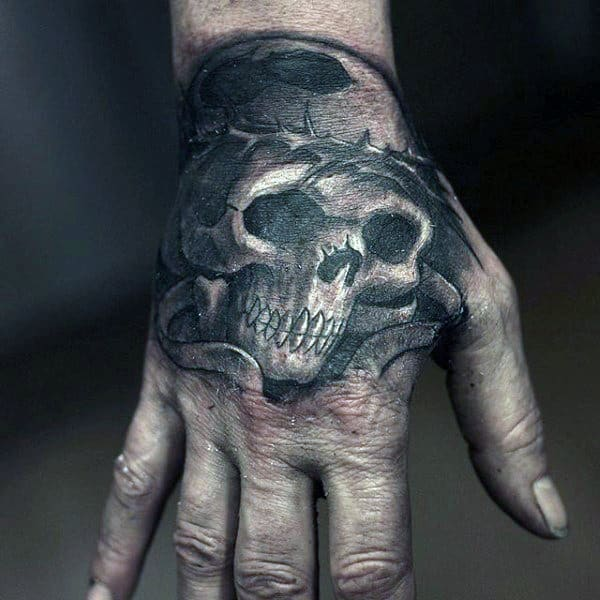 Skull With Crown Of Thorns Mens Hand Tattoo