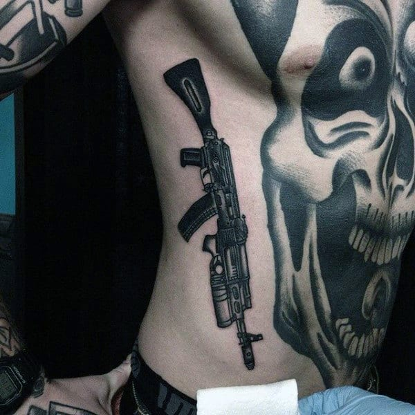 Skull With Firearm Insane Mens Ribs And Chest Tattoos