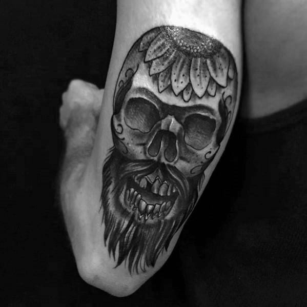 Skull With Flower And Beard Male Back Of Arm Tattoo