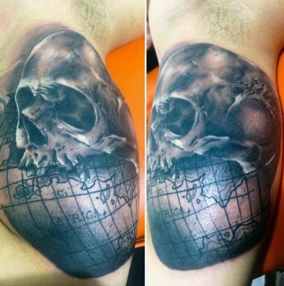 Skull With Globe Map Tattoo On Mans Bicep