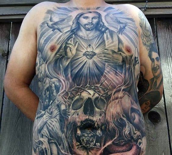 Skull With Glowing Jesus Male Tattoo Designs On Chest