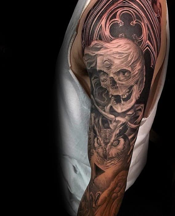 Skull With Owl And Church Window Sleeve Tattoo For Men