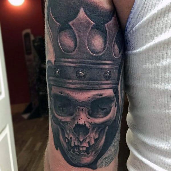 Skull With Rusty Crown Tattoo On Biceps For Men