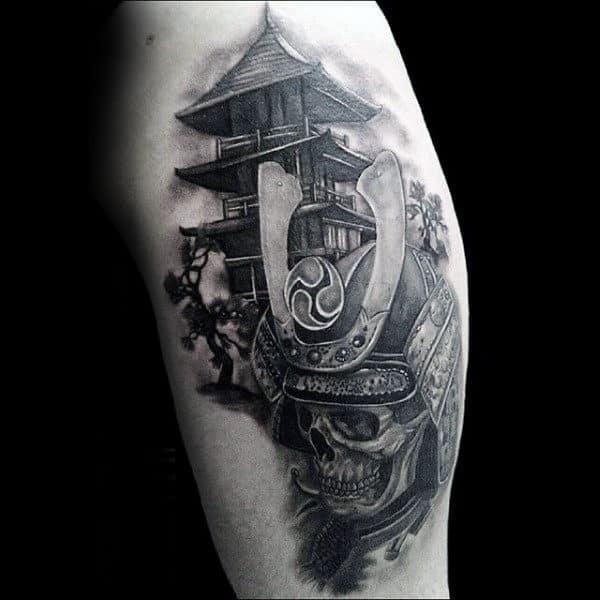 Skull With Samurai Helmet And Tower Mens Upper Arm Tattoos
