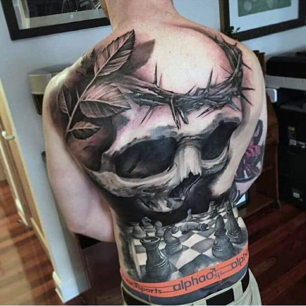 Skull With Thorns And Chess Board Modern Male Back Tattoos
