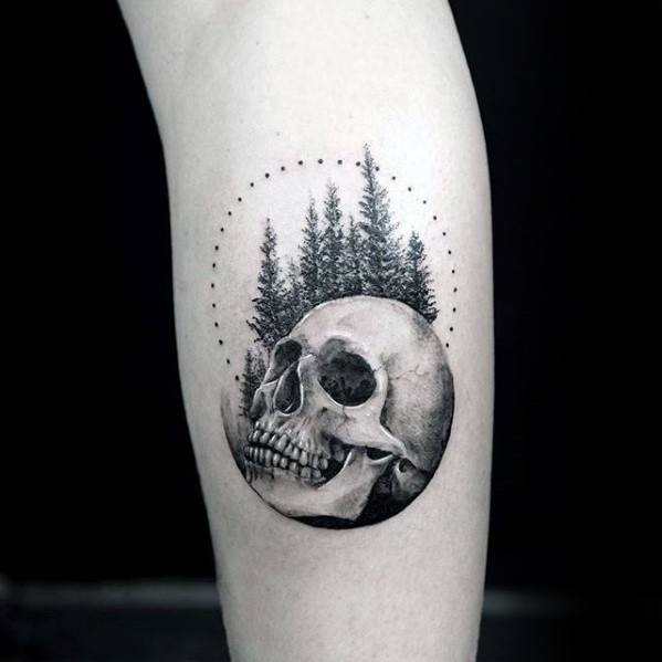 Skull With Trees And Circle Mens Small Detailed Tattoo On Leg