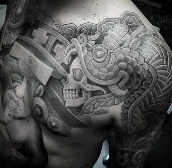 Skull With Tribal Design Guys Different Chest And Arm Tattoos