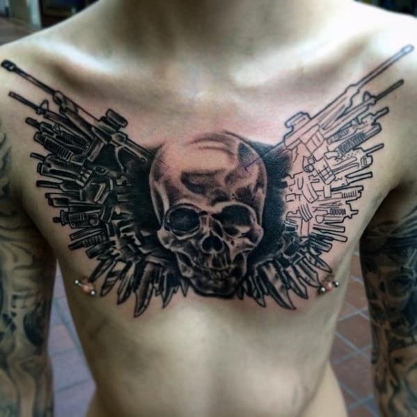 Skull With Weapons Guys Expendables Themed Upper Chest Tattoo