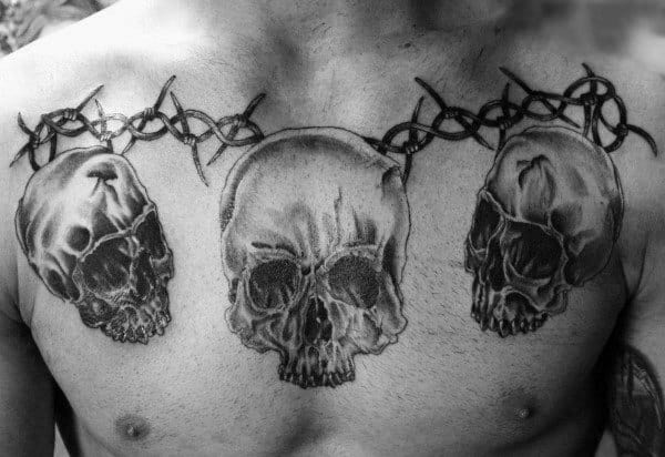 Skulls And Barbed Wire Mens Chest Tattoo Design Ideas