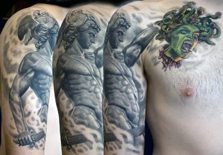 Sleeve And Upper Chest Perseus Sword With Green Medusa Snake Head Tattoo On Man