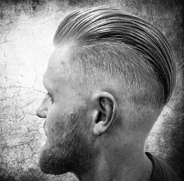 Slicked Back Mens Hair With Skin Fade
