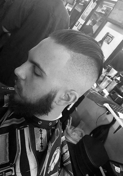 Slicked Back Skin Fade Haircut For Males