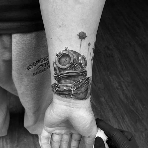 Small 3d Wrist Diving Helmet Tattoo Ideas On Guys