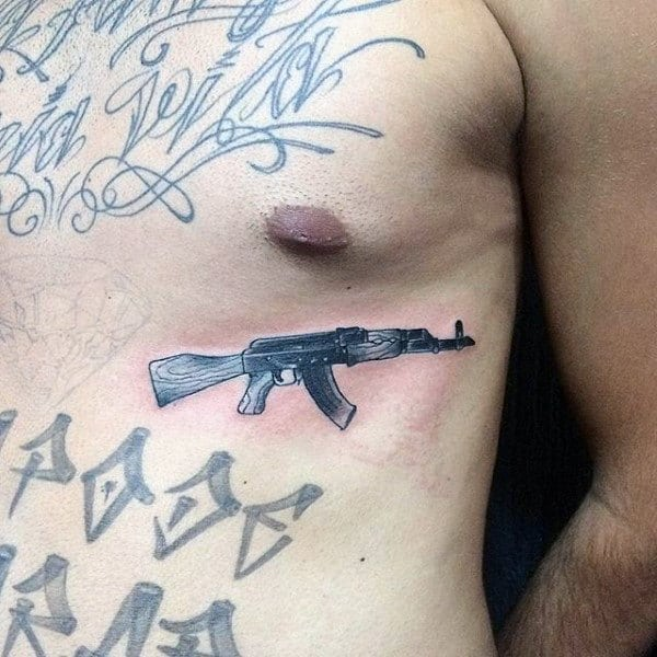 Small Ak 47 Tattoo Guys Chest
